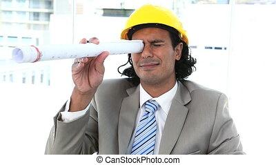 Businessman looking through a blueprint