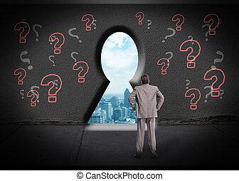 Businessman looking through keyhole.