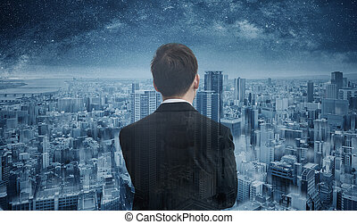 Businessman looking to futuristic blue city with starry sky. Smart business, business vision and futuristic business technology