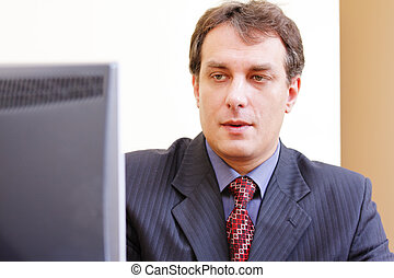 Businessman looking to monitor