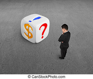 businessman looking white dice