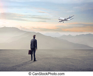 businessman looks airplane - businessman with briefcase...