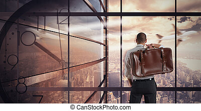 Businessman looks at view - Very busy businessman relaxes...
