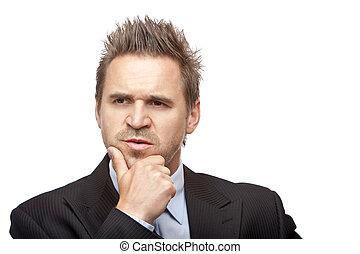Businessman looks contemplative because of a problem - ...