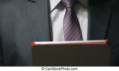 Businessman looks for text using a computer