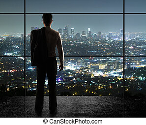 night city - businessman looks in night city