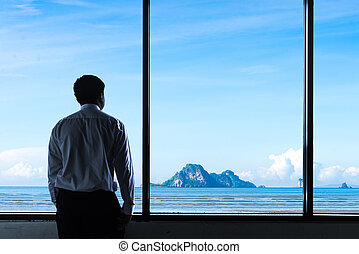businessman looks out to sky
