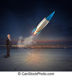 Businessman looks start a missile. Concept of company startup and new business. 3D Rendering.