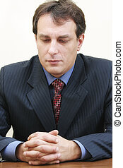 Businessman lost in thoughts