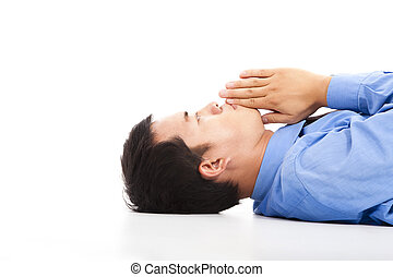 businessman lying on floor with praying