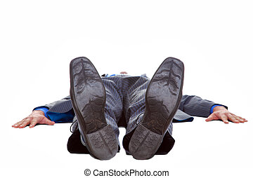 Businessman lying on his back isolated
