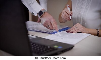 Businessman makes a deal with client in the office. - Close...