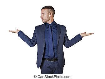 Businessman making a balance gesture