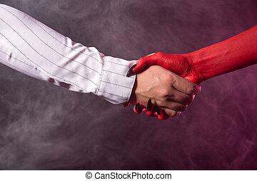 Businessman making an agreement with devil - Businessman...