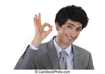 businessman making an OK sign