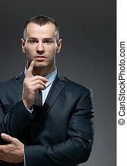 Businessman making attention gesture