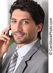 Businessman making call using mobile telephone