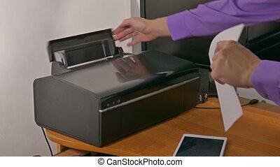 businessman man in office prints documents on printer -...