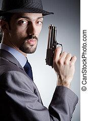 Businessman man with hand gun