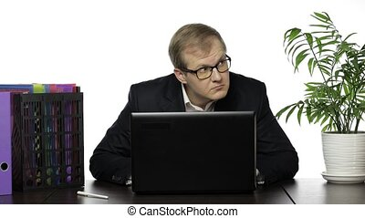 Businessman manager hides behind a laptop and looks out ...