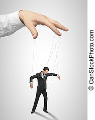 Businessman marionette on ropes controlled hand