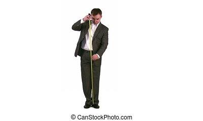 businessman measure length - The businessman will measure...
