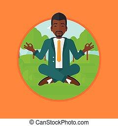 Businessman meditating in lotus position.