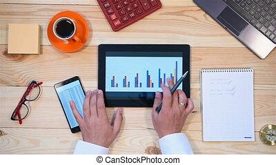 Businessman Monitoring Stock Statistics - Businessman Using...
