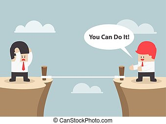 "Businessman motivate his friend to cross the cliff by saying ""You Can Do It"""
