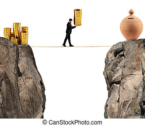 Businessman moves a pile of coins to a moneybox. concept of difficulty to saving money