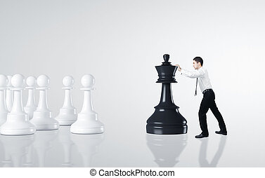 businessman moving chess