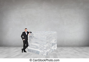 Businessman near big ice cube