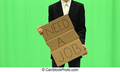 Young unemployed business man with Need a Job sign.