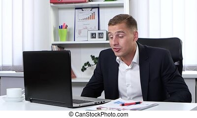 Businessman nervously talking to clients on the web camera