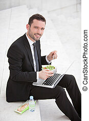 Businessman never stops working ! - Attractive businessman...