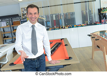 businessman next to football table in an office