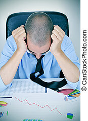 businessman observing a chart with a downward trend