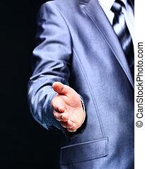 Businessman offer handshake to his partner on dark background