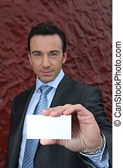 Businessman offering a blank business card