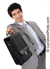 Businessman offering briefcase