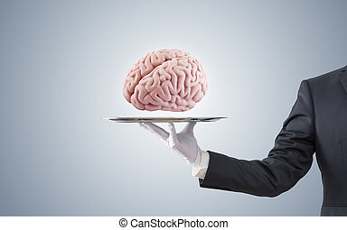 Businessman offering human brain on silver tray