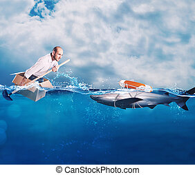 Businessman on a cardbox in the ocean looks for an help. Help with deception concept