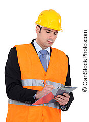 businessman on a construction site taking notes