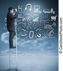 Businessman on a ladder using binoculars next to drawings