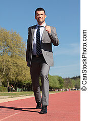 businessman on a running track in spring