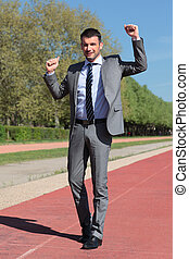 businessman on a running track in summer