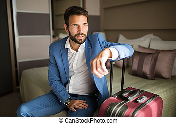 Businessman on business trip - Businessman in suit on a...