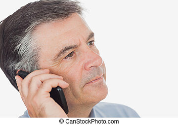 Businessman on call while looking away