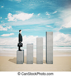Businessman on chart element - Caucasian businessman in...