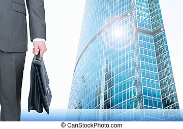 Businessman on cityscape background